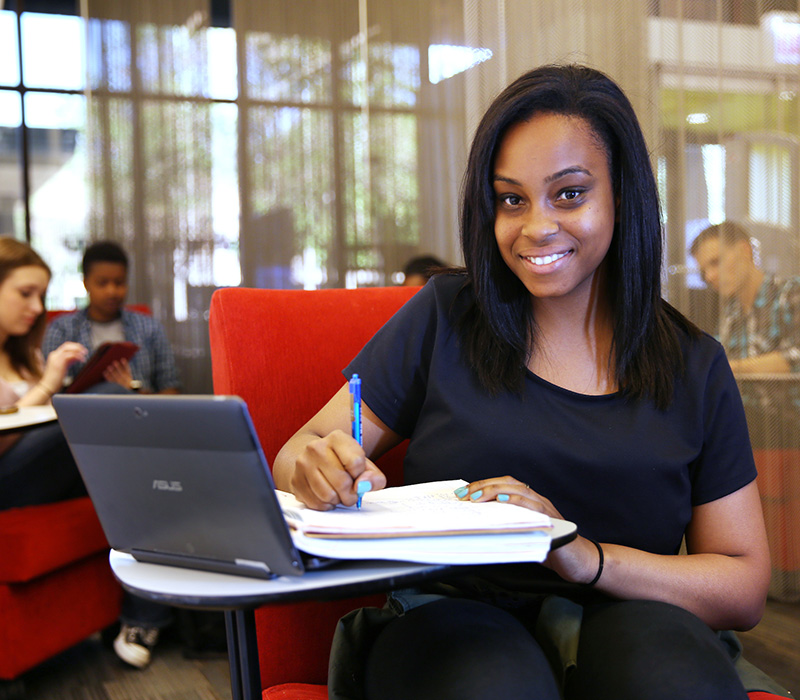 Student working near laptop